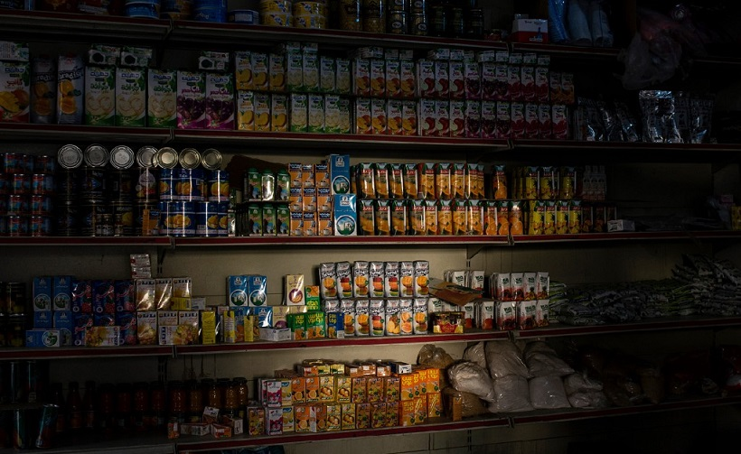 Light shines on goods in a convenience store in Sanaa