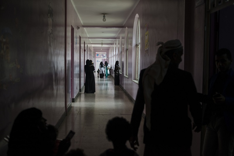 Yemeni families and nurses walk through the malnutrition wing at Sabaeen Hospital in Sanaa on May 4, 2018. Most hospitals in the north are functioning at a minimal levels, constantly short on supplies, while their staff have remained unpaid for months
