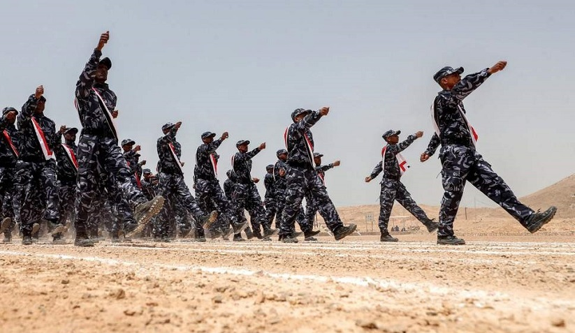 UAE-trained cadets of the Yemeni police, supporting forces loyal to the Saudi and UAE-backed government, marching during their graduation in the southeastern port city of Mukalla ( AFP/Getty )