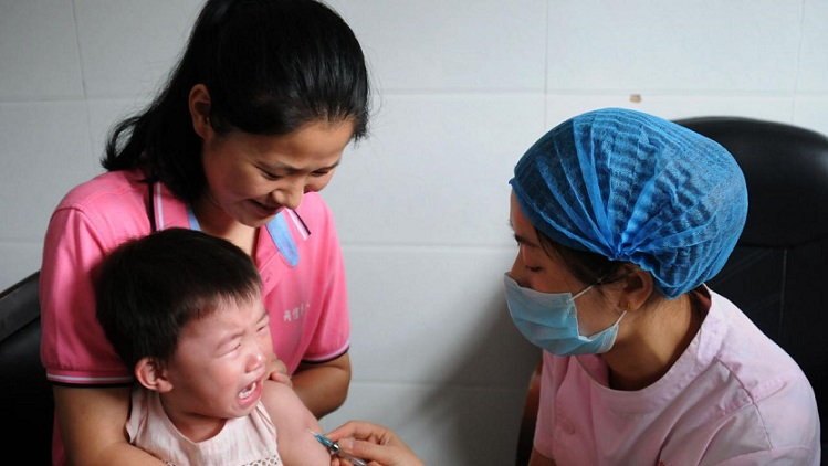China sacks regional officials as vaccine scandal mounts