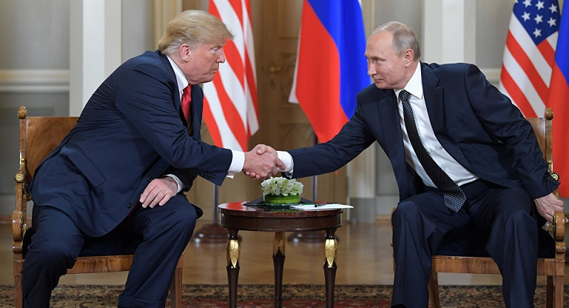 Putin shakes hands with Trump - Archive