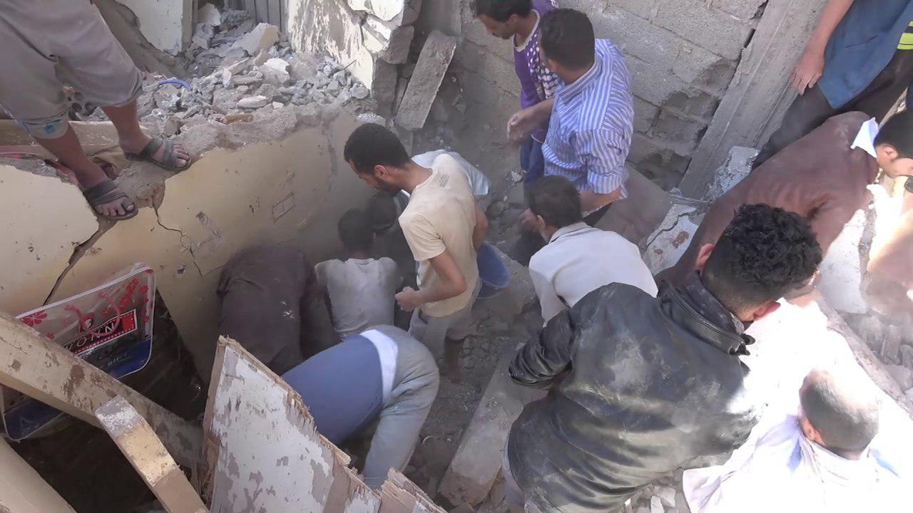 Civilian bodies taken out of ruins