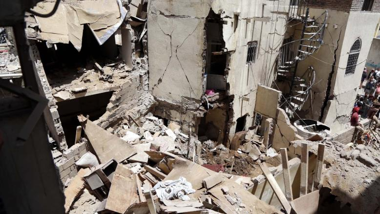 A coalition air raid last month hits a residential neighborhood in Sana'a, killing many civilians.